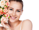 Portrait of attractive caucasian smiling woman blond with roses isolated on white studio shot — Stok fotoğraf
