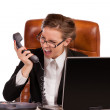 Stock Photo: Office rage series - businesswomreceived bad news over phone and is screaming in rage