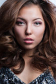 Beautiful young woman with long curly hairs — Stock Photo