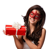 Beautiful Woman with the Carnival mask and gift — Stock Photo