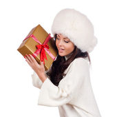 Fashion isolated woman portrait hold christmas gift. — Stock Photo