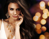 Beautiful woman with evening make-up. Jewelry and Beauty. Fashio — Stock Photo