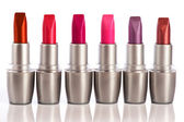 Close up of various lipsticks on white background — Stock Photo