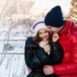 Outdoor fashion portrait of young sensual couple in cold winter wather. love and kiss — Stock Photo #40685005