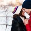 Outdoor fashion portrait of young sensual couple in cold winter wather. love and kiss — Stock Photo #40685035