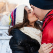 Outdoor fashion portrait of young sensual couple in cold winter wather. love and kiss — Stock Photo #40685125