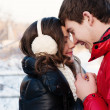 Outdoor fashion portrait of young sensual couple in cold winter wather. love and kiss — Stock Photo #40685215
