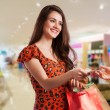 Beauty Womwith Shopping Bags in Shopping Mall. — Stock Photo #40685275