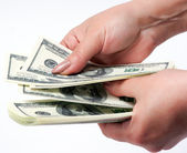 Arms counting money — Stockfoto