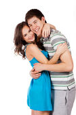 Cheerful young couple standing on white background, isolated — Stock Photo
