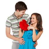 šťastný usmívající se pár v lásce. nad bílým pozadím — Stock fotografie