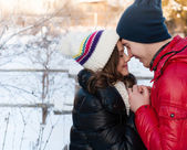 Outdoor fashion portrait of young sensual couple in cold winter wather. love and kiss — Stock Photo