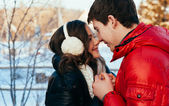 Outdoor fashion portrait of young sensual couple in cold winter wather. love and kiss — Fotografia Stock