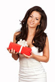 Happy Woman holding Gift Box.White background — Foto de Stock