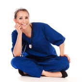 Pretty nurse doing meditation isolated on white — Stock Photo