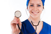Closeup of female doctor's hand holding stethoscope over white background — Foto de Stock