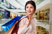 Beauty Woman with Shopping Bags in Shopping Mall. — Stock Photo