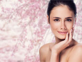 Beautiful face of young adult woman with clean fresh skin - isol — Stock Photo