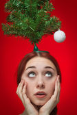 Surprised girl over red background. christmas is at hand concept — Stock Photo