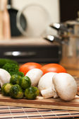 Fresh food ingredients on the kitchen table — Stock Photo