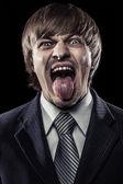 Junge unternehmer mit seiner zunge klebte schreien — Stockfoto
