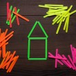 Stock Photo: House formed with green counting sticks concept