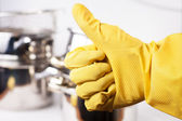 Hand in protective glove showing thumb up — Stock Photo