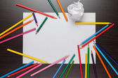 Blank sheet of paper and colorful pencils creative process — Stock Photo
