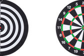 Dartboard background with white copy space — Stock Photo