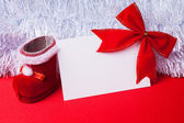 Greeting card and christmas red decoration — Stock Photo