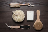 Bath accessories on brown wooden background — Stock Photo