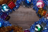 Gifts and christmas decoration over wooden background — Stock Photo