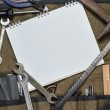 Construction tools and blank notepad - Stock Photo