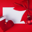 Greeting card and christmas decoration on red background - Stock Photo