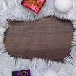Gifts and christmas decoration on wooden background — Stock Photo