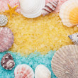 Stock Photo: Blue and yellow bath salt and seashells background