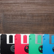 Retro technology concept diskette on wooden background - Stock Photo