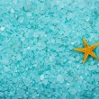 Aromatic bath salt and starfish background — Stock Photo