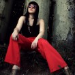 Stylish girl in red pants and glasses - Stock Photo