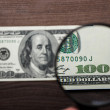 Stock Photo: Hundred dollars banknote authentication