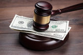 Judge gavel and money on brown wooden table — Stock Photo