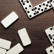 Domino pieces on the wooden table background — Stock Photo #23955381