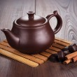 Teapot with hot tea and cinnamon sticks — Stock Photo