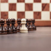 Chess leadership concept over chessboard background — Stock Photo