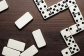 Domino pieces on the wooden table background — Stock Photo