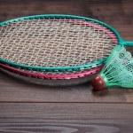Shuttlecock and badminton rackets — Stock Photo #24825205