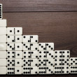 Leadership concept domino pieces forming stairs - Stock Photo