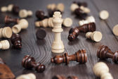 Chess win concept over wooden background — Stock Photo