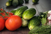 Fresh vegetables on brown wooden table — Stock Photo
