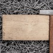 Old hammer nails and wooden board — Stock Photo #41686775